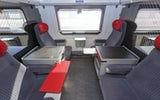 ICN: Interior view of the business zone. Interior view of a four-seat business compartment with ample space between seats and folding tables.
